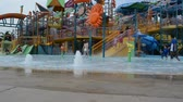 has fun : ORLANDO, USA - MARCH 25, 2014: The childrens town, all in water. Florida, USA. Akvatic aquapark. Stock Footage