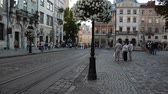fast moving : LVIV, UKRAINE - JILY 5, 2014: Architecture of Lviv, Ukraine. The corner of Market Square. Lviv, Ukraine. Stock Footage