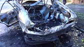 erőszak : A blown up terrorist attack. Car after terrorist attack.