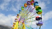 theme : big wheel with multicolored cabins in amusement park