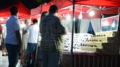 데 : BELDIBI, TURKEY - JUNE 11: Unknown people choose goods in Beloribi, Turkey.