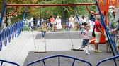 grond : Children play in the playground in the summer.