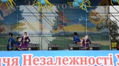 позы : Dances of the Ukrainian on the stage in the park.