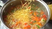 caldo : Vegetable soup cooks in a pan. Stock Footage