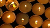 copos : Candles on a black background.
