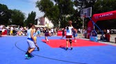 mand : UKRAINE, BERDYANSK - JULY 6, 2019: Public competitions in Streetball. Stockvideo