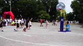 abroncs : UKRAINE, BERDYANSK - JULY 6, 2019: Public competitions in Streetball. Slow motion. Stock mozgókép