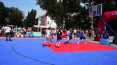 mand : UKRAINE, BERDYANSK - JULY 6, 2019: Public competitions in Streetball. Slow motion. Stockvideo