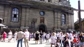 aziz : LVIV, UKRAINE - AUGUST 19, 2018: Unknown people near the Catholic Cathedral. Time lapse shoot. Stok Video