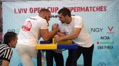 juiz : LVIV, UKRAINE - SEPTEMBER 29, 2019: Participants of a tournament on Arm wrestling Lviv Open Cup Supermatches.