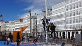 aire de jeux : LA CORU A, SPAIN - APRIL 2, 2018: Children at the playground on the city embankment. La Coru a the large city in the northwest of Spain, the resort and the port.