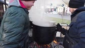 abricots : IVANO-FRANKIVSK, UKRAINE - JANUARY 7, 2020: Process of compote preparation on fire.