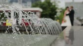 freshness : Jet fountain in the background of the bride and groom Stock Footage