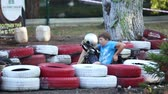karting : Amateur racing karting, leisure park visitors, the boy driver sits in the kart