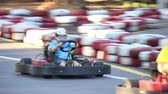 karting : Amateur racing karting, leisure park visitors, overtaking on a bend Stock Footage