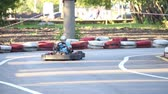 karting : Amateur racing karting, leisure park visitors, the boy is driver