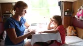 bulmaca : Woman with daughter ride in a train, they sit in the coupe and solve crossword