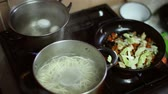 уксус : The chef mixes the cooked rice with vinegar mixture for making rolls