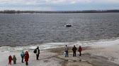 hovercraft : Passenger hovercraft is mooring to the shore on the river Volga in the winter, passengers waiting on the shore on March 13, 2016 in Samara  Samara region  Russia