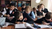 ginásio : Pupils at the school sitting in class write in notebooks and communicate