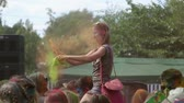 holi : The festival of colors, girl sitting on the shoulders of the guy and throws paints on people on June 12, 2016 in Samara  Samara region  Russia Stock Footage