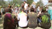 holi : The festival of colors, people throw paints, smeared with paints guys sit with his back to us on June 12, 2016 in Samara  Samara region  Russia Stock Footage