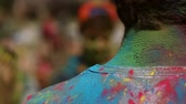 holi : The festival of colors, people throw paints, the guys neck and shirt stained with colored paints Stock Footage