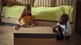 furniture : Boy and girl hammer in nails with hammers, they help parents to assemble new furniture Stock Footage