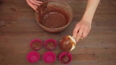 chocolate mold : Woman preparing a muffins on the kitchen Stock Footage