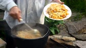 plov : Chef puts the original Uzbek pilaf in a bowl. Cooking Uzbek pilaf