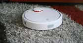 vacuuming : robotic vacuum cleaner on carpet - technology housework