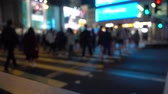 Hong Kong - Kowloon - Mong Kok - Zebra Crossing - Pedestrians crossing a road where it is green on the traffic lights - huge crowd of people, huge display lights