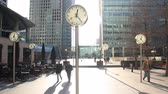 clock : Canary Wharf office buildings and clock in London