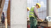 architecture : Two workers at construction site Stock Footage