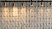 vazio : The white brick wall is hilighted with lanterns from above. Background texture Stock Footage