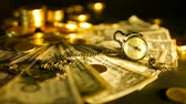 cent : Management efficiency. Stacks of golden coins dollar notes on black background. Success of finance business, investment, financial ideas concepts. Close up slill life with retro clock and soft focus