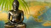 Будда : World Map. Journey Explore Concept. Abstract travel destination background with copy space. Trip Southeast Asia. Sitting buddha as symbol of asian culture. Close up slill life, soft selective focus.