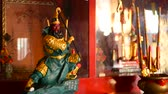 solene : Buddhist traditional statues of chinese sacred gods on the altar inside the temple Vídeos