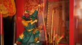 buddhista : Buddhist traditional statues of chinese sacred gods on the altar inside the temple Stock mozgókép