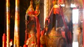 immortal : Buddhist traditional statues of chinese sacred gods on the altar inside the temple Stock Footage