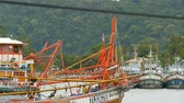 lula : KHANOM, THAILAND - SEPTEMBER 21, 2018. Rusty boats at coast. Old rusty ships parked at port in Fisherman city. Fishing Squid industry. Traditional Asia. Concept of destruction of marine resources.