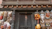 indianin : Traditional colorful Handmade wooden masks and handicrafts for sale in Kathmandu, Nepal. Souvenir Shops in Durbar of Bhaktapur and Patan. Swayambhunath decorative asian market.