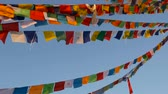 boudhanath : Colorful prayer flags flying in the wind at Boudhanath Stupa, Holy Pagoda, symbol of Nepal and Kathmandu with golgen Buddhas Eyes. Sunset ligth. Stock Footage