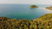 Aerial drone view small Koh Ma island, Ko Phangan Thailand. Exotic coast panoramic landscape, Mae Haad beach, summer day. Sandy path between corals. Vivid seascape, mountain coconut palms from above 무비클립