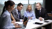 office and teamwork concept - group of business people having a meeting Stock Footage