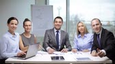 office and teamwork concept - group of business people having a meeting and showing thumbs up Stock Footage
