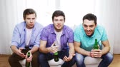 fãs : friendship, sports and entertainment concept - upset male friends with beer watching tv and clinking at home Vídeos