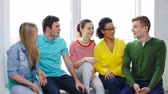 university : education, communication and happiness concept - group of smiling students having conversation at school Stock Footage