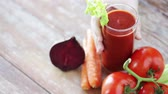aipo : healthy eating, food, dieting and people concept - close up of woman hands with tomato juice and vegetables