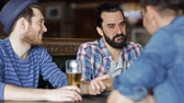 hat : people men leisure friendship and communication concept  happy male friends drinking beer at bar or pub Stock Footage